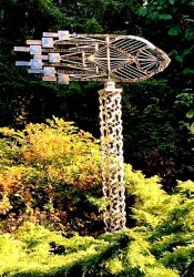 """Wayne Kangas """"Rocket Vane"""" Intricately weldedfreestanding sculptures, using found and recycled stainless  steel mechanical scrap. $3995. The sculpture turns with a gentle breeze."""
