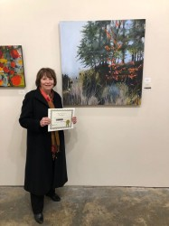 Judith Perry with her painting